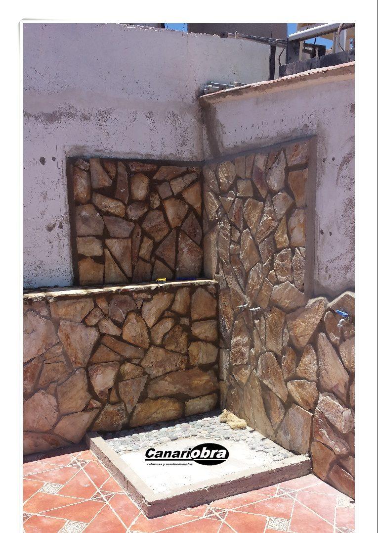Colocación lajas de piedra en terraza